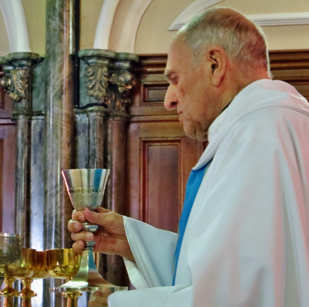Fr> Charles Gallant Presiding with True Devotion