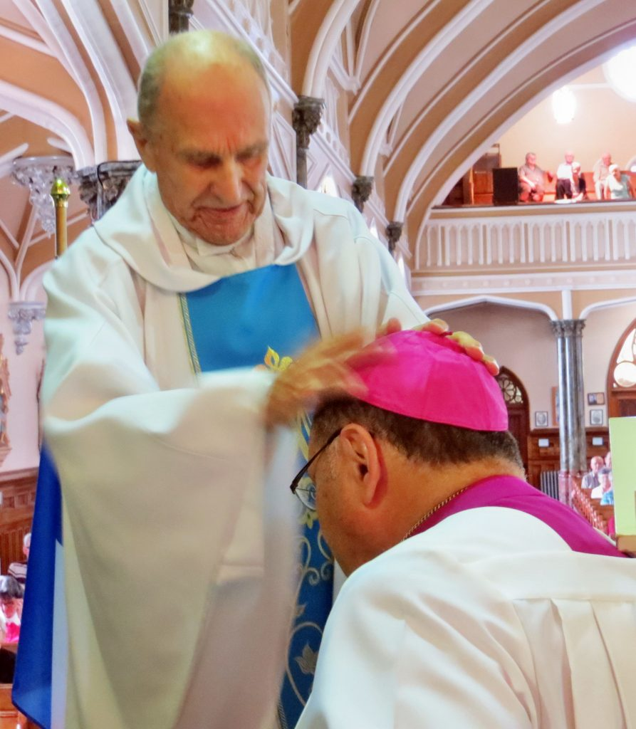 Fr. Charles Blesses Bishop Richard
