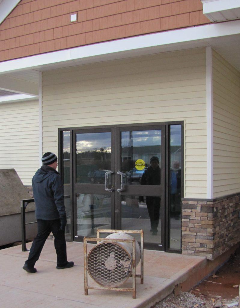 Fr. Jim Wilick heads for the front door.