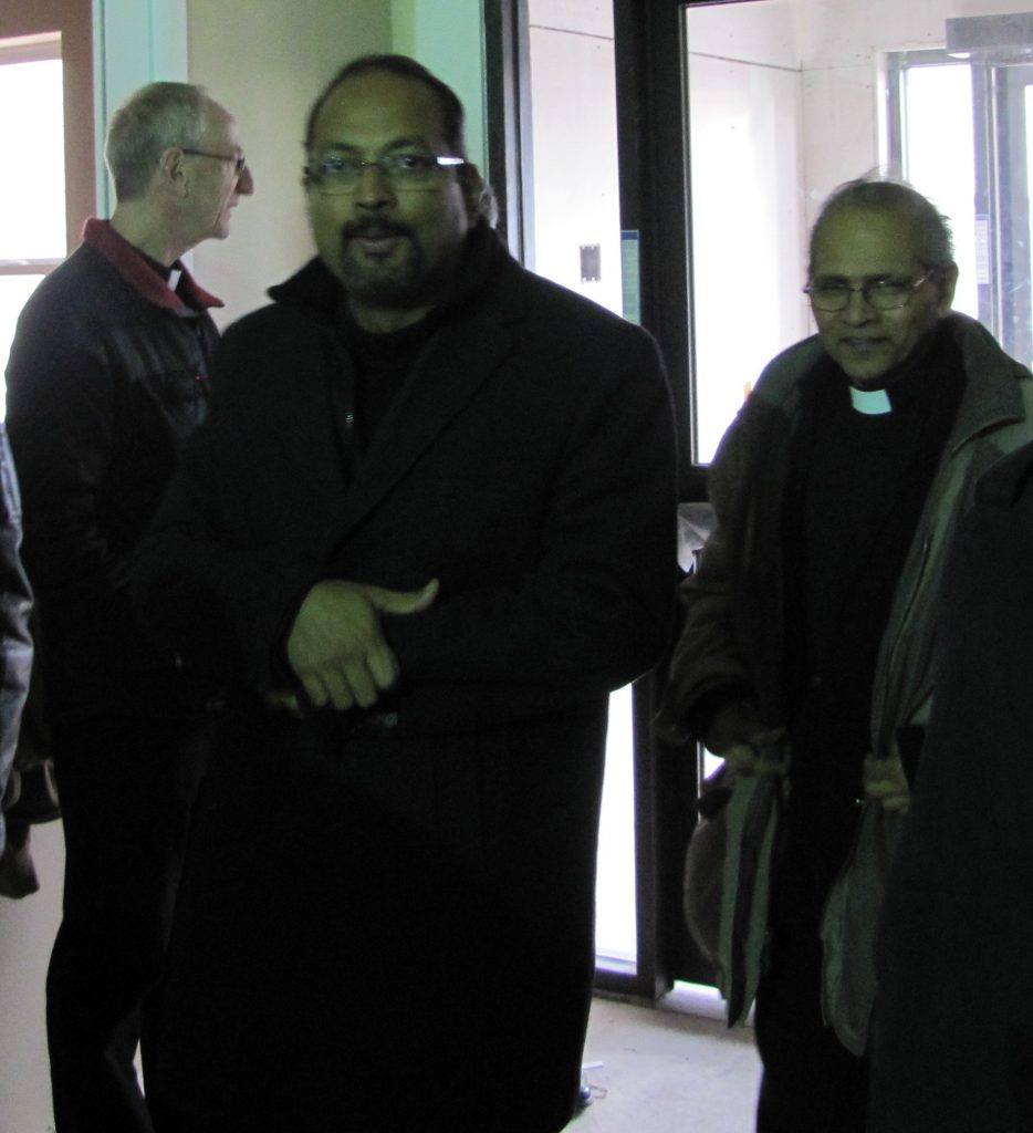 Fr. Joseph Palliyodil and Fr. George Palamattam, CMI join the group in the foyer