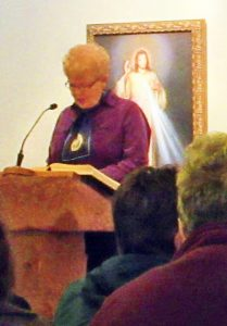 Jean Cahill gives the first scripture reading